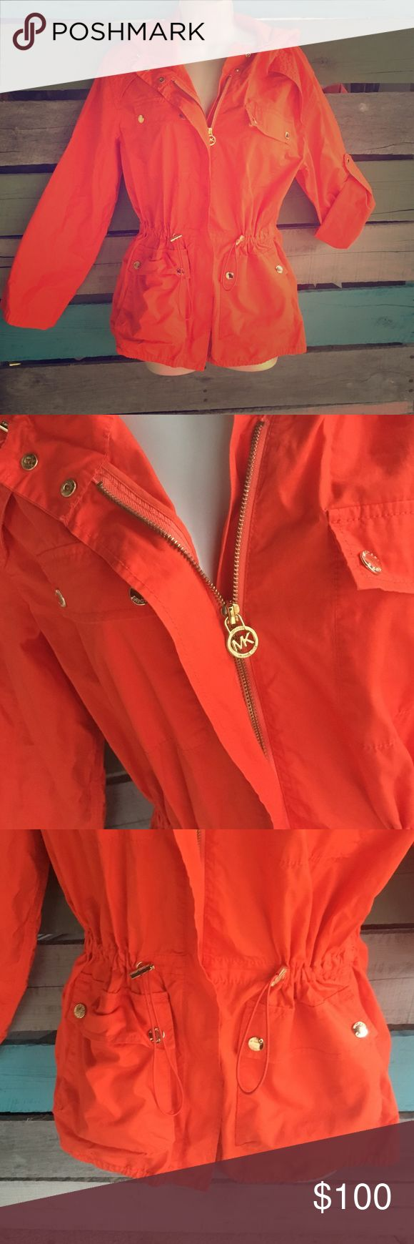Michael Kors Raincoat Brand new never worn. Features 4. Pockets on the front. A zipper to close the coat. As well as adjust cords on the sides to adjust fit to liking. The can be worn a full length and also 3/4 as shown in picture. The is a button to roll up to the sleeves. Measurements are chest: or 38 inch and length is 26 1/2 inch MICHAEL Michael Kors Jackets & Coats Trench Coats