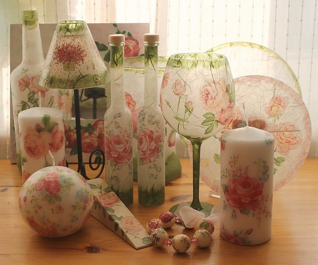 Love this look. Decoupage-probably done with napkins or tissue paper.
