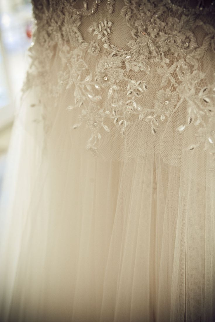 Floral, beaded Spanish lace and soft, tea-dyed, layered tulle.