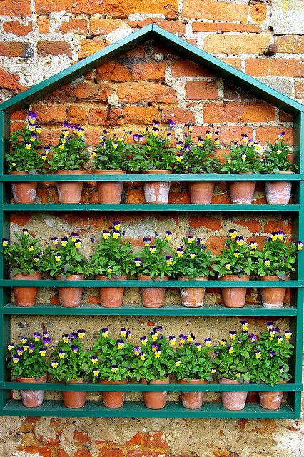 Wall mounted pot display, Grey's Court, Oxon