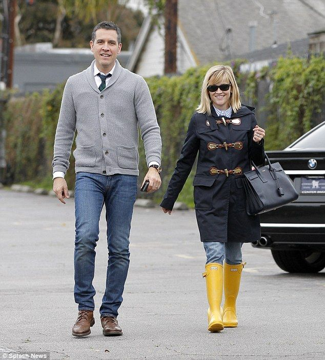 Awww! Celebrity couple Reese Witherspoon and husband Jim Toth brave the rain to step out for a romantic lunch date in Venice, California. via dailymail.co.uk
