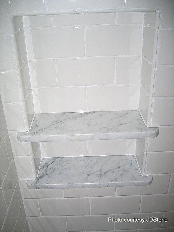 white subway with carrara marble. This would be a beautiful shower nook, but I think I would need more than one