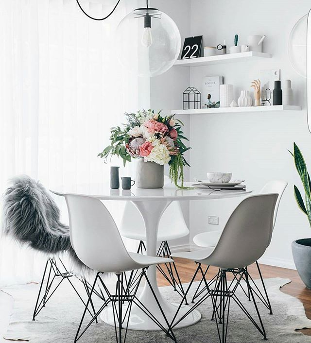 Absolutely love midmod chairs and tulip tables.