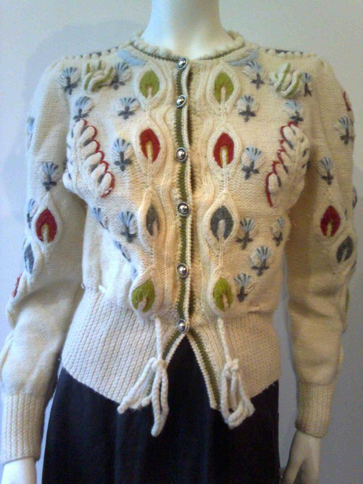 Offwhite cardigan with embroided blue, red and green parts, frontclosure , size 36