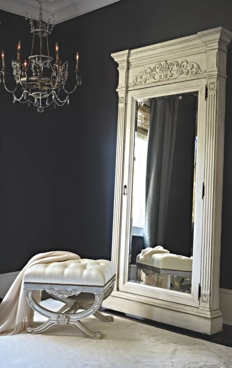 Styled after an 18th century French trumeau mirror and given a relaxed, antiqued white finish, this piece gains modern functionality with a velvet-lined interior for storing jewelry and accessories.