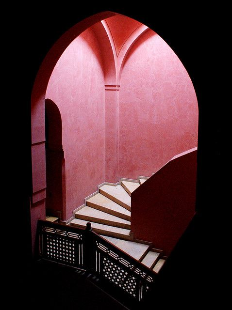 Gorgeous pinkish red hues brighten the Royal Theatre in Marrakesh, Morocco.