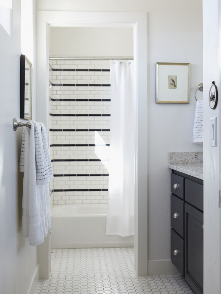 subway tile accented with black banding every 4th row