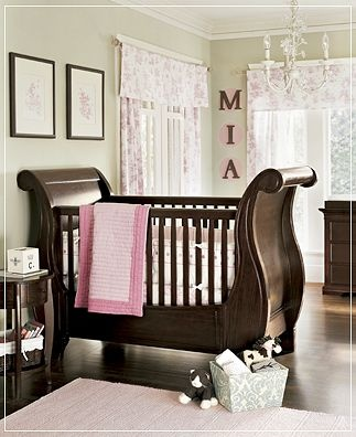 Love this baby room. I saw it on an ad, and I had to find a picture of it. The colors are perfect together. The pale green from the walls, the dark wood and the pinks. So perfect!