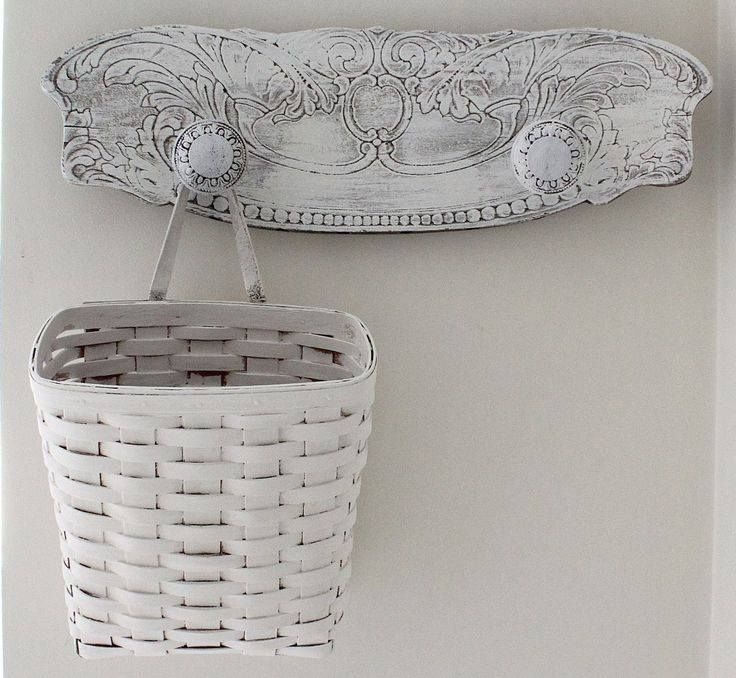 A salvaged piece from a broken chair is recreated into a shabby chic rack.....