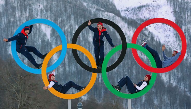 Dominic Harrington, Ben Kilner and Billy Morgan of the Great Britain Snowboard Team pose for a portrait with Rebekah Wilson and Paula Walker of the Great Britain Bobsleigh team on the Olympic rings at the Athletes Village in the Rosa Khutor mountain village cluster prior to the Sochi 2014 Winter Olympics