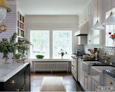 """preppy « Search Results « Elements of Style Blog    """"The kitchen is a classic beauty- subway, brass bin pulls and marble and granite tops (notice the smart flip flop of finishes- carerra on black cabinets, black granite on white cabinets)"""""""