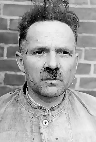 """Krakow, Poland, Postwar, Rudolf Hoss, the commandent of Auschwitz, in prison after being questioned as to his real identity. He was given away by his wife who feared she and her son were to be sent to the USSR a trick by British arm intelligence paid off and she gave his assumed name and location. He was arrested and later hanged for war crimes."""