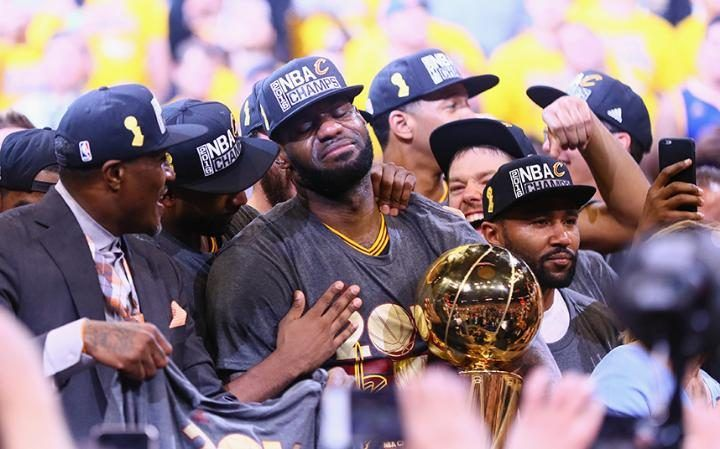 An emotional LeBron James holds the Championship Trophy after making history with NBA Finals win over Golden State Warriors. With the victory over the Stephen Curry's top-seeded defending champions, the Cavaliers became the first team to rally from a 3-1 series deficit in the best-of-seven NBA Finals and win the title.