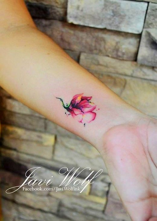 Flower watercolor tattoo on girl's wrist | watercolor flower tattoo designs.