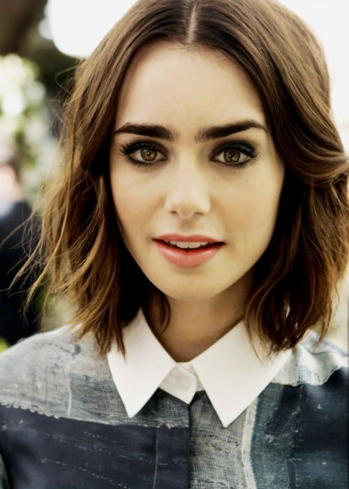 Lily Collins - we love this #brunette long bob with a centre parting! #lob