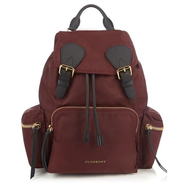 Burberry Medium nylon backpack ($1,153) ❤ liked on Polyvore featuring bags, backpacks, red, quilted nylon bag, burgundy backpack, day pack backpack, zip backpack and backpack bags