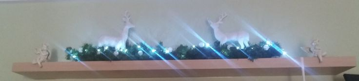 DIY - Top self christmas decor with battery operating lights branches  and sparlky reindeer's.