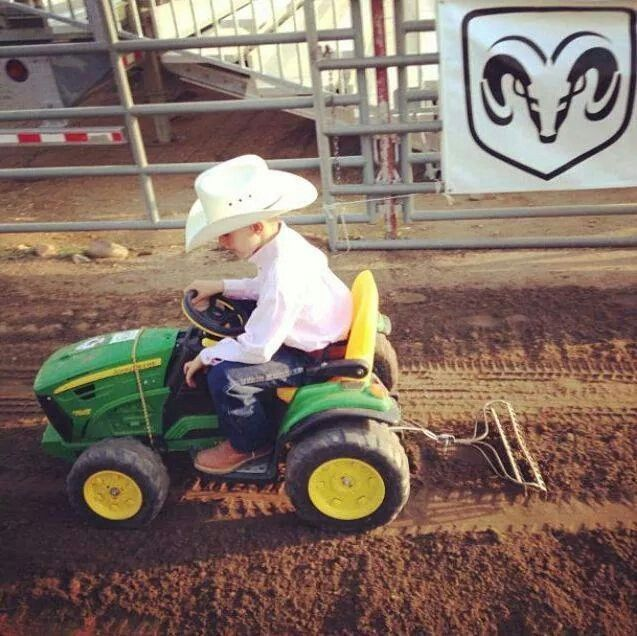 Cute little cowboy.  Raking with a potato rake.  Cute!!