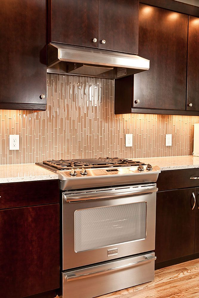 Tile backsplash - use them vertically. Why didn't I think of that?!