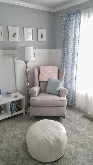 Sweet and calm gray nursery. Pottery Barn Wingback rocker. Land of Nod ottoman pouf. Baby animal prints from Etsy. DIY board and batten.