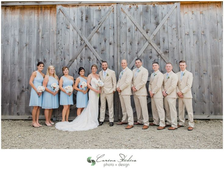 Impression Bridal wedding dress and beautiful light blue bridesmaids dresses from David's Bridal.  Light tan tuxes from Men's Warehouse.  The perfect colors for an outdoor wedding!