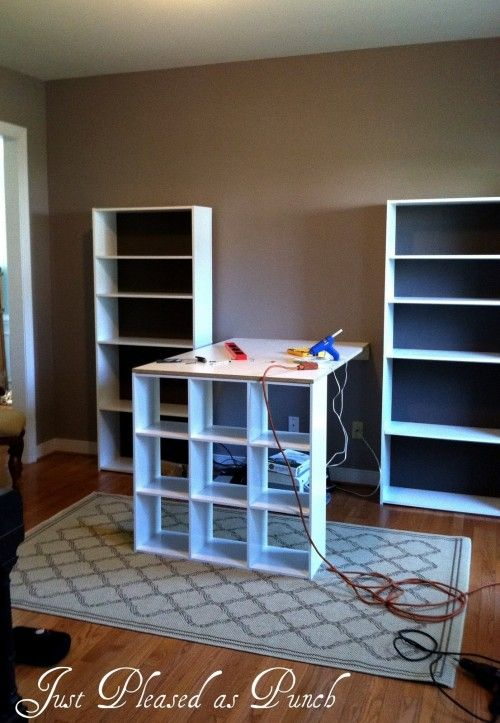 A Budget-Friendly Craft Room: could put two book cases on either side of the window then use a folding table coming out like this from the window. Put existing pieces I have along the wall. That will leave room for a bed or an air mattress if I need one in that room.