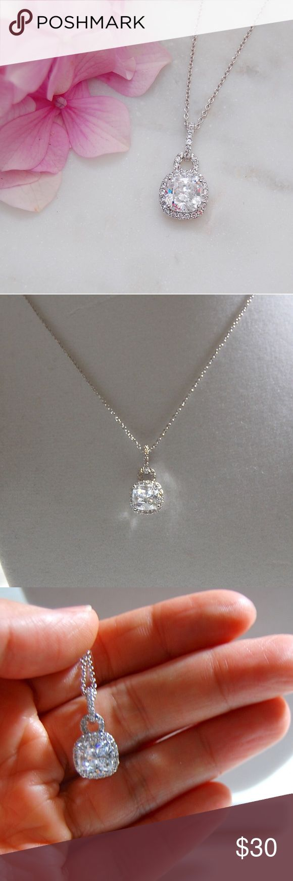 CZ Pendant Necklace | Cushion Cut Cushion cut cubic zirconia pendant necklace. Large CZ is around 2 karats. Pendant hangs a little over .75 inches long. Necklace is 17 inches with a lobster clasp and 2 inch extender. Price firm unless bundled. Includes box.    Instagram: @bringingupsuns Jewelry Necklaces