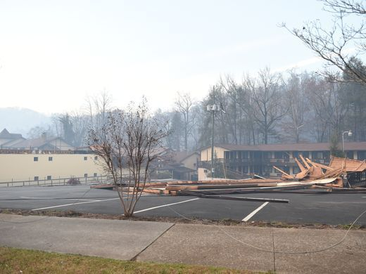 Wind damage blew a roof off of a hotel after wildfires
