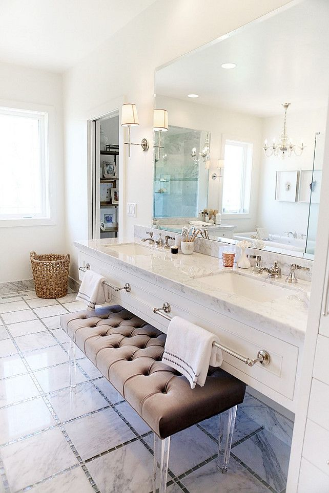 Floating Bathroom Vanity with Marble and Large Towel Bars via Home Bunch