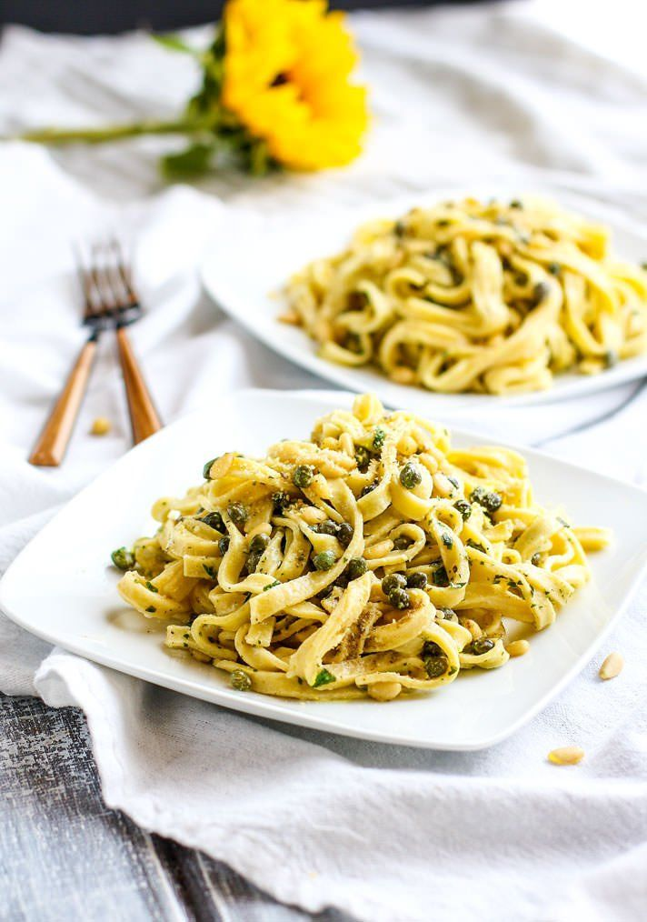 Healthy Fettuccine Pasta with Capers, Pine Nuts, and herbed greek yogurt sauce. A Fettuccine recipe is light in flavor but also a bit creamy and comforting. A gluten free fettuccine pasta dish that's ready in 30 minutes and will nourish you and your whole family.