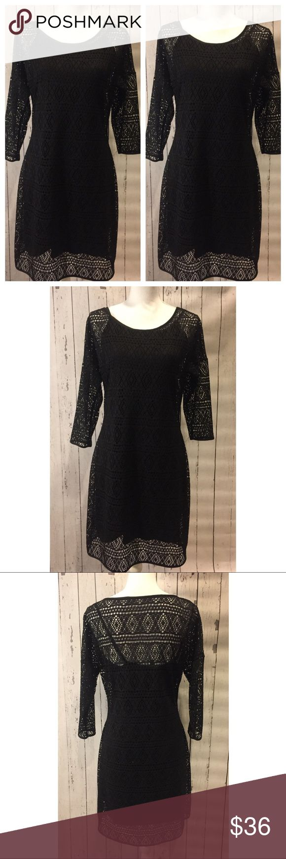 Express Aztec Crochet Overlay Dress NWOT long sleeve dress is two layers of sexy! Outer layer is an Aztec / diamond crochet design with long sleeves, and inner layer is a plain black tank dress! Shoulder to hem 36 inches. Express Dresses Midi