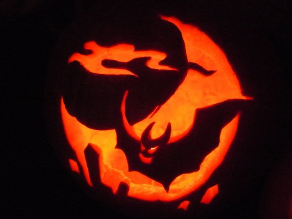 Halloween Pumpkin by unfoundfemale990 - Bat flying over graves under a full moon