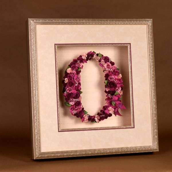 Rearrange your bouquet into a monogram, displayed in a shadowbox.