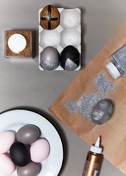 Just add glitter! Apply painter's tape to the area of the egg you want to keep paint-free. Use glue to cover the exposed area, then sprinkle with glitter. Carefully remove the tape to reveal the final design. More modern Easter egg decorations at Chatelaine.com