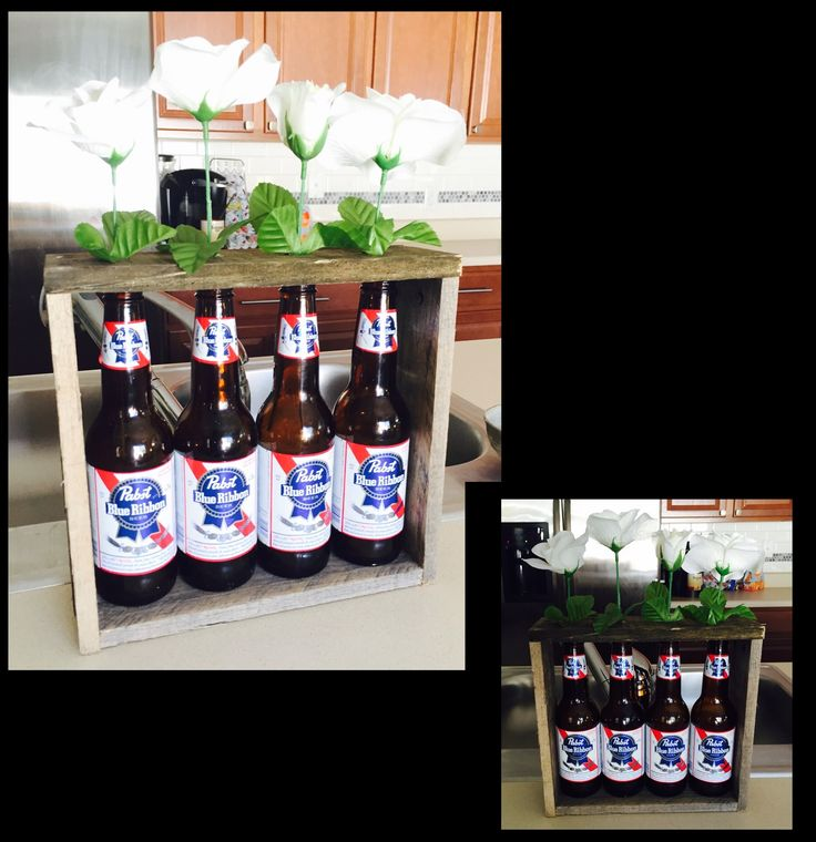 Beer bottle frame, will fit any standard long neck bottle.  Created a frame around the bottles and drilled holes for the bottle opening in the top wood piece.  Can be used as vases, displays etc.