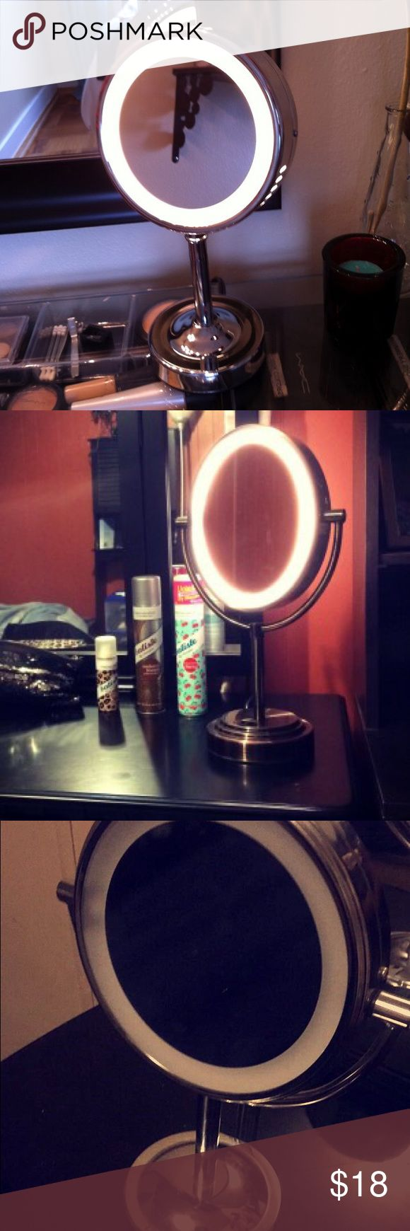 Conair double sided light-up makeup mirror Lights up| double sided mirror| good for makeup vanity| good condition| runs on batteries| offer button conair Makeup