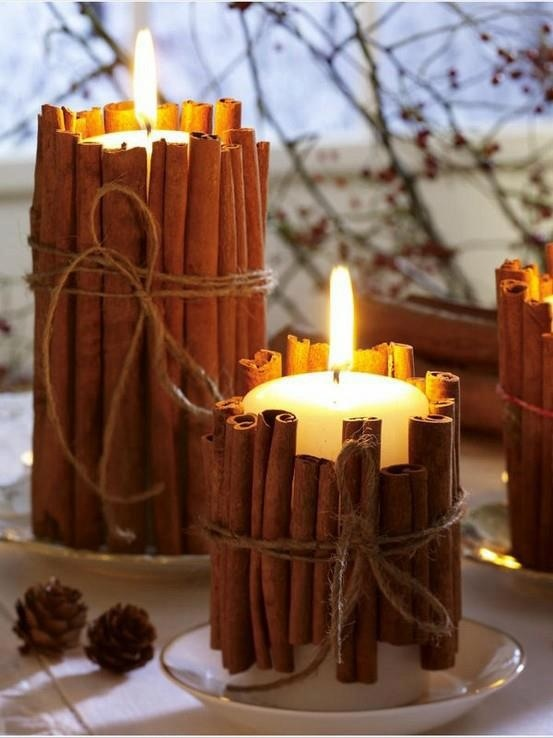Simple cinnamon candles... Glue cinnamon sticks onto candle with glue gun and tie with raffia.