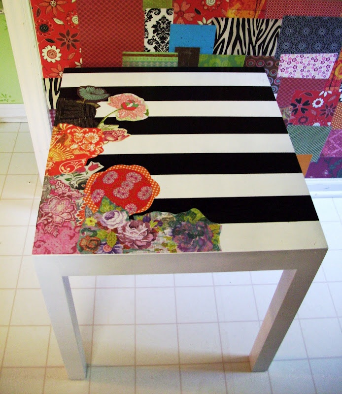 <3THIS...I painted this table white...added the black stripes, then decoupaged the flowers on top.  SHOULD SEAL THIS TOO.