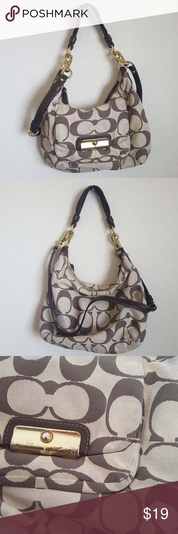 """Brown and taupe coach hobo bag Brown and taupe coach medium hobo bag. Has some discoloration and signs of wear, but has a lot of life left. I never use it anymore, so it needs to go to a good home. Comes with adjustable/removable crossbody leather strap. With gold accents.  14"""" width  10"""" depth 11"""" handle 30"""" crossbody strap Coach Bags Hobos"""