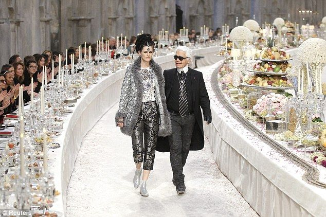 British model Stella Tennant accompanies designer Karl Lagerfeld to mark the end of the show.  Look at those tables laden with food.  Hard to believe there are people starving in the world.