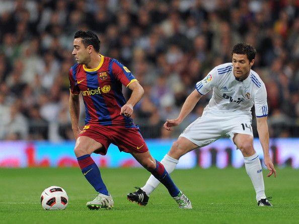 Xabi Alonso Photostream Xabi Alonso Xavi Hernandez Real Madrid And Barcelona