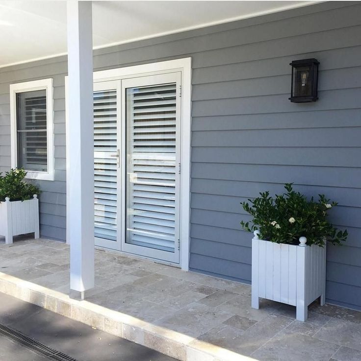 Beautiful plantation-style shutters and Scyon Linea by @curtisroaddreamhouse. Stunning. #australianarchitecture #architecture #exteriordesign #exterior #scyonwalls