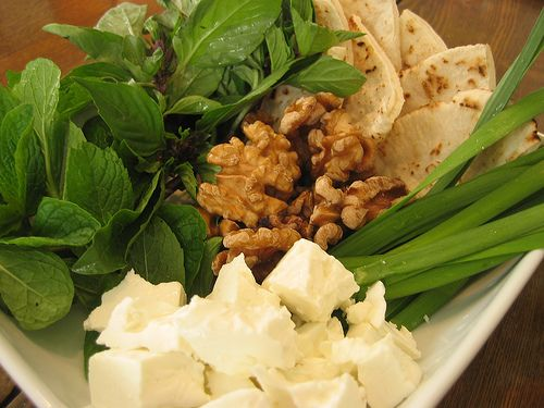 Persian snacks. Feta cheese, fresh Ming, walnut and bread.
