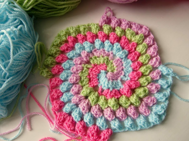 granny bobble spiral square---this is cute.  I may have to try this stitch soon.