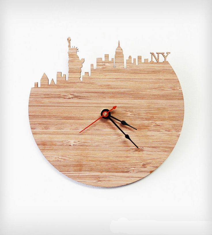 New York Modern Wall Clock By iluxo Jewelry and Design. Cherry bamboo wood wall clock with the Statue of Liberty, Empire State Building and more iconic pieces of the NYC skyline.
