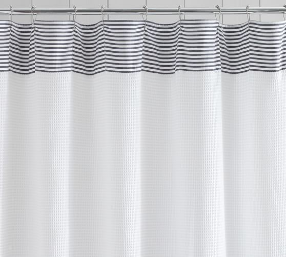 bands of dobby trim add fresh color to our textured shower curtain from turkey woven in a waffleweave pattern for a soft feel and fluid folds
