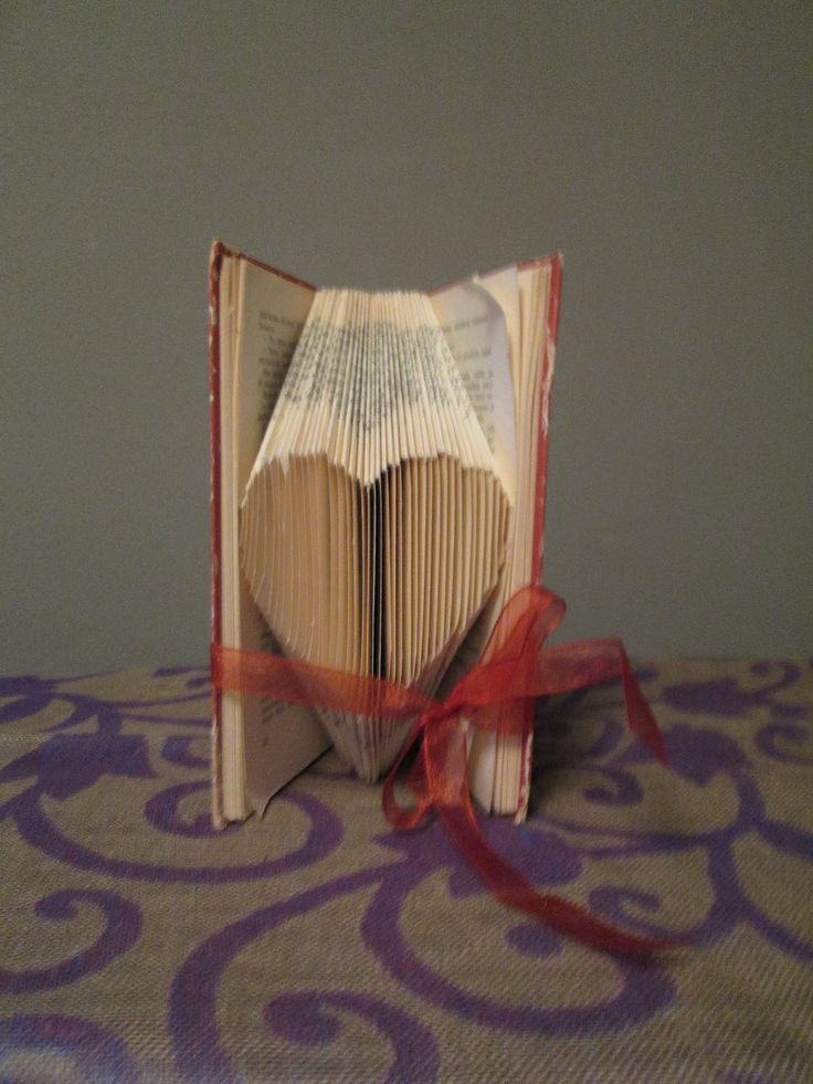 Folded heart with red ribbon.  Kirjasta sydän - punaisella nauhalla. The pattern I purchased from website http://foldedbookart.com  Ystävänpäivänä hyvälle iältään vanhimmalle 90-v ystävälle.