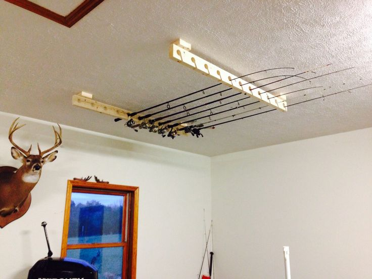 Cheap fishing rod storage!  Made out of scrap 2x4's.  Skill saw, hole saw,and a drill are that's needed.