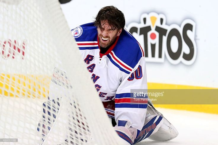 Henrik Lundqvist #30 of the New York Rangers reacts after being hit by Cody Eakin #20 of the Dallas Stars in the first period at American Airlines Center on December 15, 2016 in Dallas, Texas.