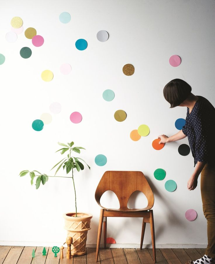 A white wall is scattered with colored dots, making it look like a giant funfetti cake/DIY decoration.